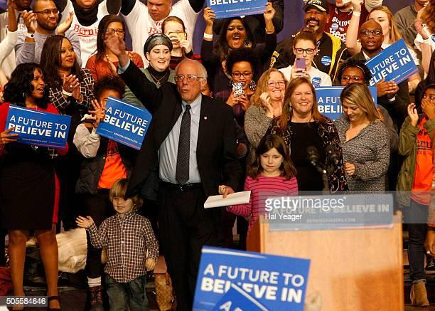 Democratic presidential candidate Sen Bernie Sanders walks with wife Jane Sanders and other family members as he prepares to speak at Boutwell...