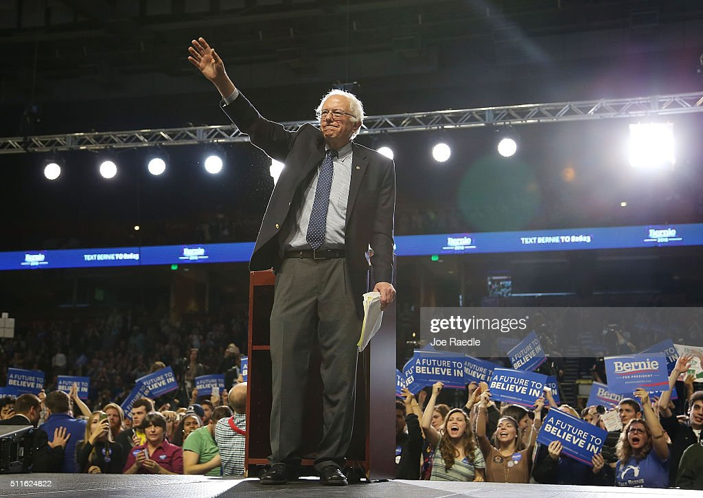 Democratic presidential candidate Sen Bernie Sanders waves after speaking during a Future to Believe In rally at the Bon Secours Wellness Arena on...