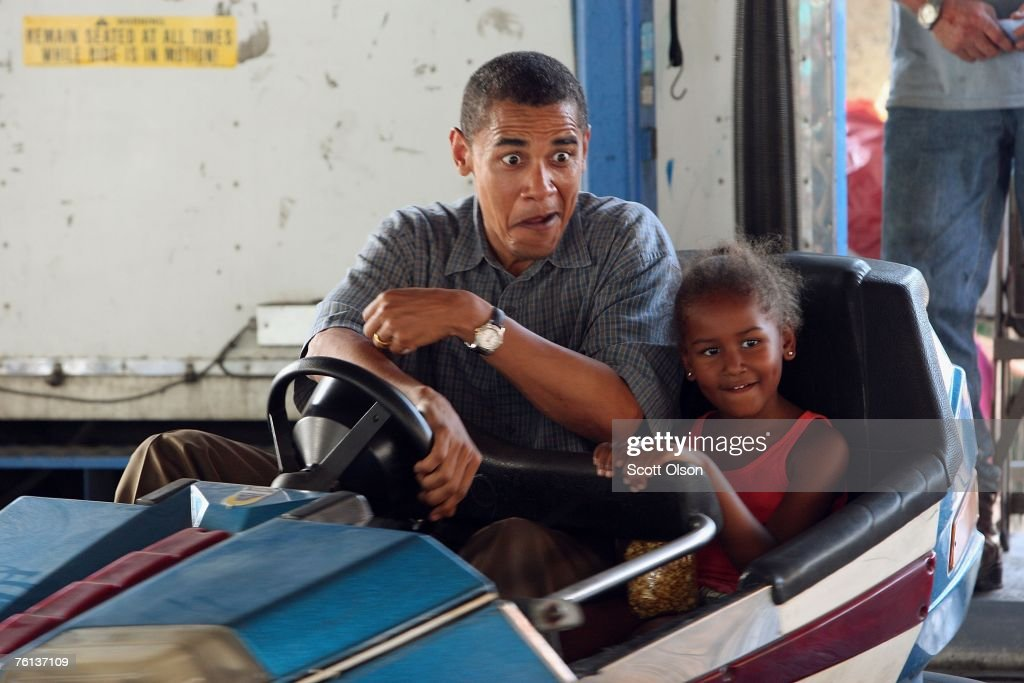 Democratic Presidential Candidate Senator <a gi-track='captionPersonalityLinkClicked' href=/galleries/search?phrase=Barack+Obama&family=editorial&specificpeople=203260 ng-click='$event.stopPropagation()'>Barack Obama</a> (D-IL) drives a bumper car with his daughter Sasha at the Iowa State Fair August 16, 2007 in Des Moines, Iowa. The fair runs until August 19th and is expected to draw about 1 million people. John Edwards also made a campaign stop at the fair today.