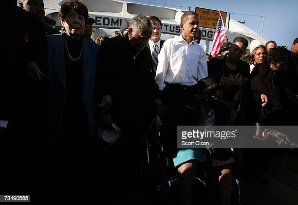 Democratic Presidential candidate Senator Barack Obama marches with a crowd across the Edmund Pettus Bridge to commemorate the 1965 'Bloody Sunday'...