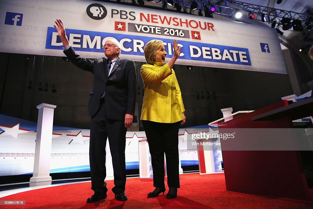 Democratic presidential candidate Senator Bernie Sanders and Hillary Clinton participate in the PBS NewsHour Democratic presidential candidate debate...