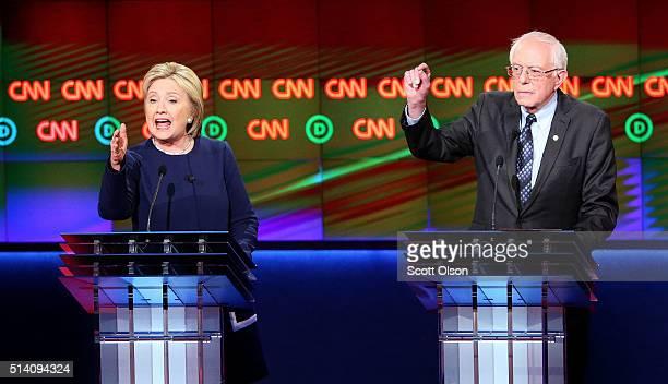 Democratic presidential candidate Senator Bernie Sanders and Democratic presidential candidate Hillary Clinton speak during the CNN Democratic...
