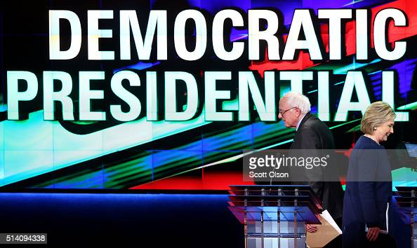 Democratic presidential candidate Senator Bernie Sanders and Democratic presidential candidate Hillary Clinton walk off stage during a break in the...