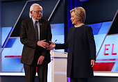 Democratic presidential candidate Senator Bernie Sanders and Democratic presidential candidate Hillary Clinton shake hands on stage before the...