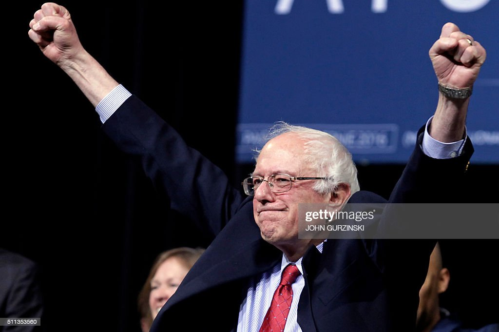 Democratic presidential candidate Senator Bernie Sanders greets the audience during a campaign event in Henderson Nevada on February 19 2016 the day...