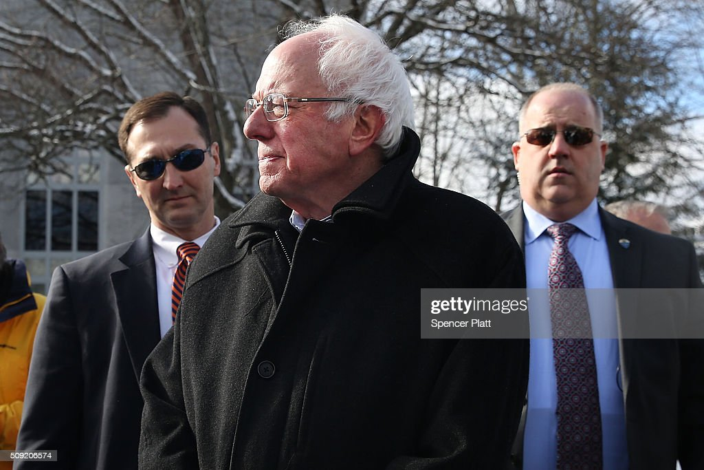 Democratic presidential candidate Senator <a gi-track='captionPersonalityLinkClicked' href=/galleries/search?phrase=Bernie+Sanders&family=editorial&specificpeople=2908340 ng-click='$event.stopPropagation()'>Bernie Sanders</a> (D-VT) is surrounded by his security detail as he walks through downtown Concord on election day on February 9, 2016 in Concord, New Hampshire. Sanders, who is expected to win over Democratic rival Hillary Clinton, greeted voters before taking a short walk where he was mobbed by members of the media.