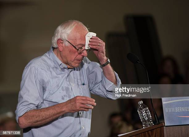 Democratic Presidential candidate Senator Bernie Sanders of Vermont wiping sweat off his forehead at a campaign rally in Salem NH on August 23 2015