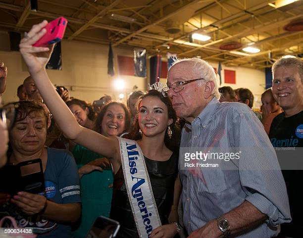 Democratic Presidential candidate Senator Bernie Sanders of Vermont shooting a selfie with Allie Nault of Manchester NH 'Miss Americas Outstanding...