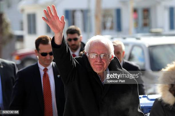 Democratic presidential candidate Senator Bernie Sanders walks through downtown Concord on election day on February 9 2016 in Concord New Hampshire...