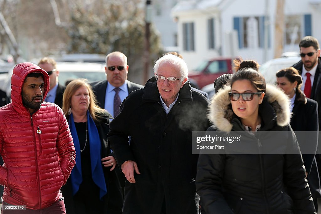 Democratic presidential candidate Senator <a gi-track='captionPersonalityLinkClicked' href=/galleries/search?phrase=Bernie+Sanders&family=editorial&specificpeople=2908340 ng-click='$event.stopPropagation()'>Bernie Sanders</a> (D-VT) walks through downtown Concord on election day on February 9, 2016 in Concord, New Hampshire. Sanders, who is expected to win over Democratic rival Hillary Clinton, greeted voters before taking a short walk where he was mobbed by members of the media.
