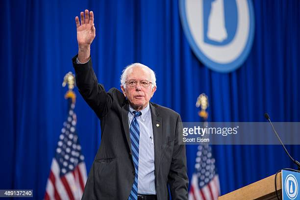 Democratic Presidential candidate Senator Bernie Sanders waves while leaving stage during the New Hampshire Democratic Party State Convention on...