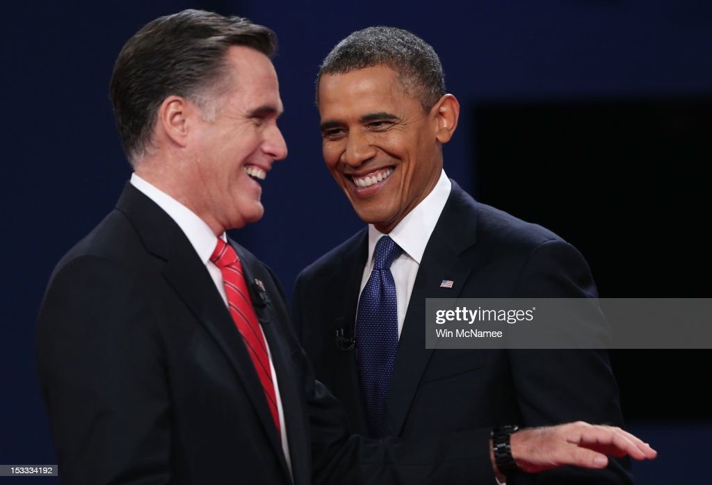 Democratic presidential candidate, U.S. President <a gi-track='captionPersonalityLinkClicked' href=/galleries/search?phrase=Barack+Obama&family=editorial&specificpeople=203260 ng-click='$event.stopPropagation()'>Barack Obama</a> (R) and from Republican presidential candidate, former Massachusetts Gov. <a gi-track='captionPersonalityLinkClicked' href=/galleries/search?phrase=Mitt+Romney&family=editorial&specificpeople=207106 ng-click='$event.stopPropagation()'>Mitt Romney</a> (L) smile after the Presidential Debate at the University of Denver on October 3, 2012 in Denver, Colorado. The first of four debates for the 2012 Election, three Presidential and one Vice Presidential, is moderated by PBS's Jim Lehrer and focuses on domestic issues: the economy, health care, and the role of government.