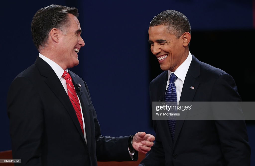 Democratic presidential candidate, U.S. President <a gi-track='captionPersonalityLinkClicked' href=/galleries/search?phrase=Barack+Obama&family=editorial&specificpeople=203260 ng-click='$event.stopPropagation()'>Barack Obama</a> (R) and Republican presidential candidate, former Massachusetts Gov. <a gi-track='captionPersonalityLinkClicked' href=/galleries/search?phrase=Mitt+Romney&family=editorial&specificpeople=207106 ng-click='$event.stopPropagation()'>Mitt Romney</a> (L) smile after the Presidential Debate at the University of Denver on October 3, 2012 in Denver, Colorado. The first of four debates for the 2012 Election, three Presidential and one Vice Presidential, is moderated by PBS's Jim Lehrer and focuses on domestic issues: the economy, health care, and the role of government.