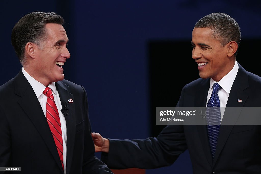 Democratic presidential candidate, U.S. President Barack Obama (R) and Republican presidential candidate, former Massachusetts Gov. Mitt Romney (L) smile after the Presidential Debate at the University of Denver on October 3, 2012 in Denver, Colorado. The first of four debates for the 2012 Election, three Presidential and one Vice Presidential, is moderated by PBS's Jim Lehrer and focuses on domestic issues: the economy, health care, and the role of government.