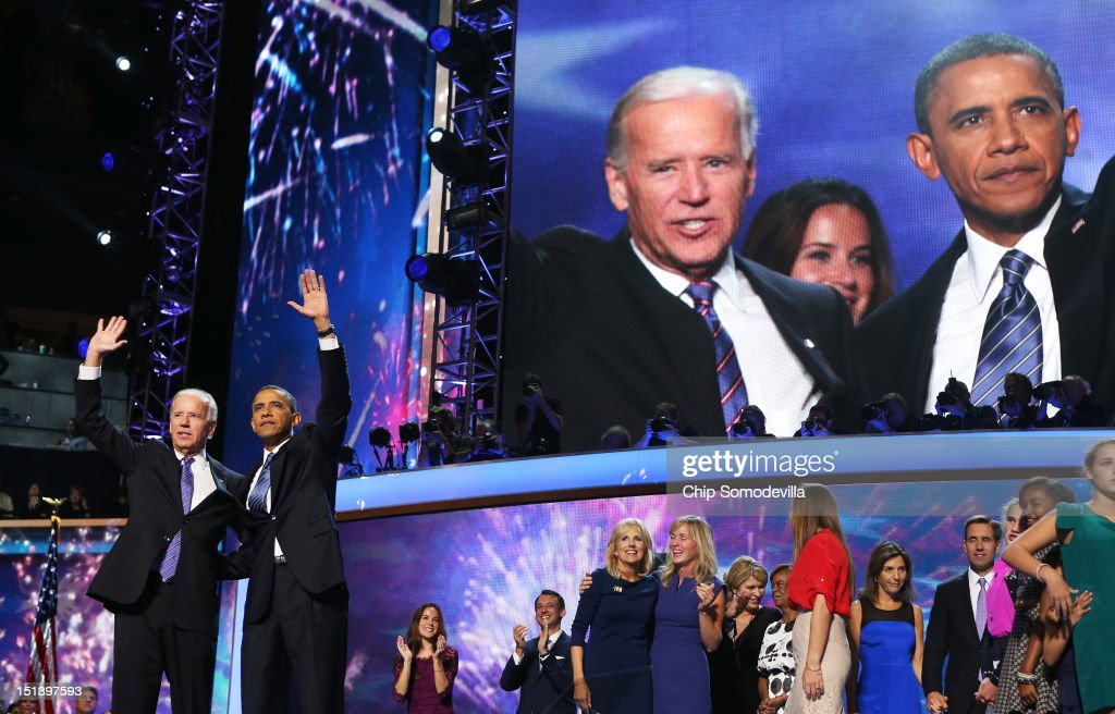 Democratic presidential candidate, U.S. President Barack Obama and Democratic vice presidential candidate, U.S. Vice President Joe Biden wave after accepting the nomination on stage with family during the final day of the Democratic National Convention at Time Warner Cable Arena on September 6, 2012 in Charlotte, North Carolina. The DNC, which concludes today, nominated U.S. President Barack Obama as the Democratic presidential candidate.