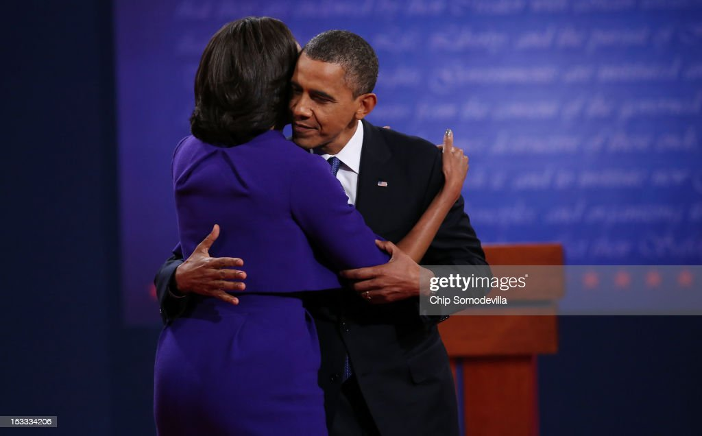 Democratic presidential candidate, U.S. President <a gi-track='captionPersonalityLinkClicked' href=/galleries/search?phrase=Barack+Obama&family=editorial&specificpeople=203260 ng-click='$event.stopPropagation()'>Barack Obama</a> (R) hugs his wife and First lady <a gi-track='captionPersonalityLinkClicked' href=/galleries/search?phrase=Michelle+Obama&family=editorial&specificpeople=2528864 ng-click='$event.stopPropagation()'>Michelle Obama</a> after the Presidential Debate at the University of Denver on October 3, 2012 in Denver, Colorado. The first of four debates for the 2012 Election, three Presidential and one Vice Presidential, is moderated by PBS's Jim Lehrer and focuses on domestic issues: the economy, health care, and the role of government.