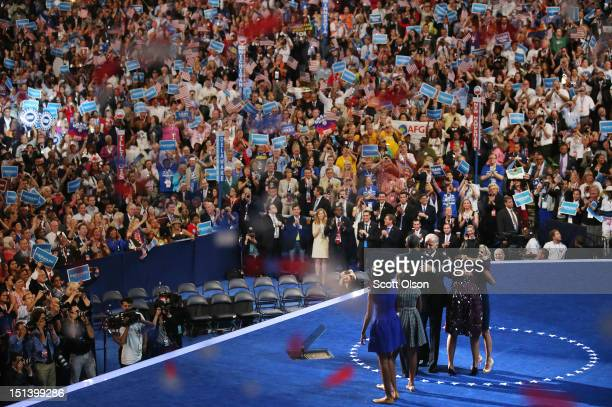 Democratic presidential candidate US President Barack Obama hugs Democratic vice presidential candidate US Vice President Joe Biden as Second lady Dr...