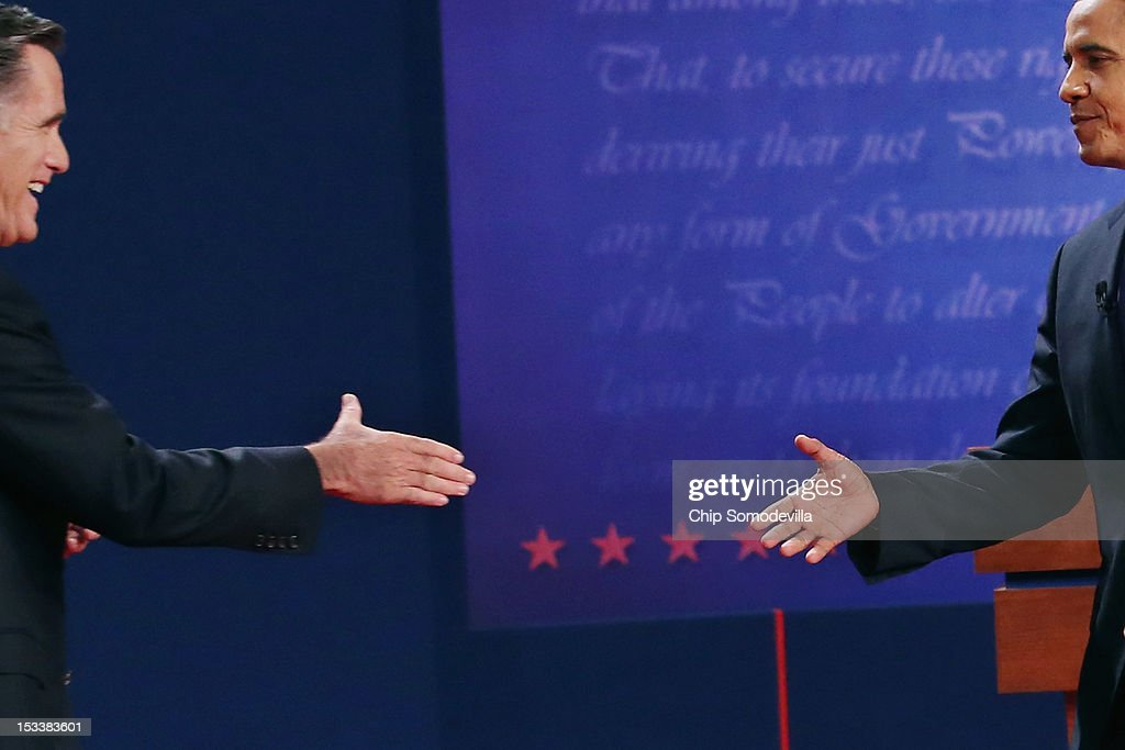 Democratic presidential candidate, U.S. President Barack Obama (R) shakes hands with Republican presidential candidate, former Massachusetts Gov. Mitt Romney (L) after the Presidential Debate at the University of Denver on October 3, 2012 in Denver, Colorado. The first of four debates for the 2012 Election, three Presidential and one Vice Presidential, is moderated by PBS's Jim Lehrer and focuses on domestic issues: the economy, health care, and the role of government.