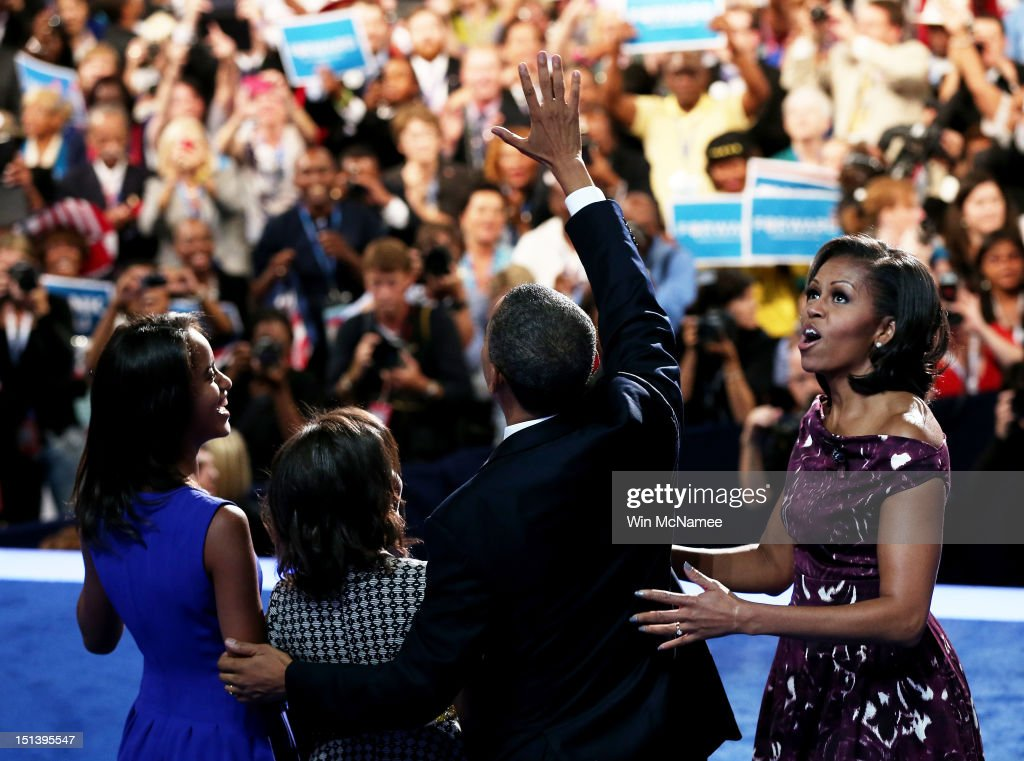 Democratic presidential candidate, U.S. President <a gi-track='captionPersonalityLinkClicked' href=/galleries/search?phrase=Barack+Obama&family=editorial&specificpeople=203260 ng-click='$event.stopPropagation()'>Barack Obama</a> stands on stage after accepting the nomination with his family, (L-R) <a gi-track='captionPersonalityLinkClicked' href=/galleries/search?phrase=Malia+Obama&family=editorial&specificpeople=2631620 ng-click='$event.stopPropagation()'>Malia Obama</a>, <a gi-track='captionPersonalityLinkClicked' href=/galleries/search?phrase=Sasha+Obama&family=editorial&specificpeople=2631619 ng-click='$event.stopPropagation()'>Sasha Obama</a>, and First lady <a gi-track='captionPersonalityLinkClicked' href=/galleries/search?phrase=Michelle+Obama&family=editorial&specificpeople=2528864 ng-click='$event.stopPropagation()'>Michelle Obama</a> during the final day of the Democratic National Convention at Time Warner Cable Arena on September 6, 2012 in Charlotte, North Carolina. The DNC, which concludes today, nominated U.S. President <a gi-track='captionPersonalityLinkClicked' href=/galleries/search?phrase=Barack+Obama&family=editorial&specificpeople=203260 ng-click='$event.stopPropagation()'>Barack Obama</a> as the Democratic presidential candidate.