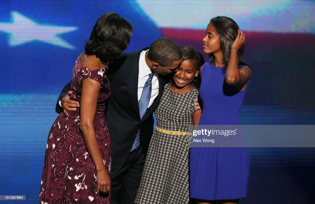Democratic presidential candidate, U.S. President <a gi-track='captionPersonalityLinkClicked' href=/galleries/search?phrase=Barack+Obama&family=editorial&specificpeople=203260 ng-click='$event.stopPropagation()'>Barack Obama</a> stands on stage with First lady <a gi-track='captionPersonalityLinkClicked' href=/galleries/search?phrase=Michelle+Obama&family=editorial&specificpeople=2528864 ng-click='$event.stopPropagation()'>Michelle Obama</a> (L) , <a gi-track='captionPersonalityLinkClicked' href=/galleries/search?phrase=Sasha+Obama&family=editorial&specificpeople=2631619 ng-click='$event.stopPropagation()'>Sasha Obama</a> and <a gi-track='captionPersonalityLinkClicked' href=/galleries/search?phrase=Malia+Obama&family=editorial&specificpeople=2631620 ng-click='$event.stopPropagation()'>Malia Obama</a> (R) after accepting the nomination during the final day of the Democratic National Convention at Time Warner Cable Arena on September 6, 2012 in Charlotte, North Carolina. The DNC, which concludes today, nominated U.S. President <a gi-track='captionPersonalityLinkClicked' href=/galleries/search?phrase=Barack+Obama&family=editorial&specificpeople=203260 ng-click='$event.stopPropagation()'>Barack Obama</a> as the Democratic presidential candidate.