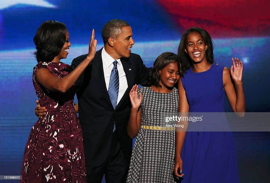 Democratic presidential candidate, U.S. President <a gi-track='captionPersonalityLinkClicked' href=/galleries/search?phrase=Barack+Obama&family=editorial&specificpeople=203260 ng-click='$event.stopPropagation()'>Barack Obama</a> stands on stage with (R-L) First lady <a gi-track='captionPersonalityLinkClicked' href=/galleries/search?phrase=Michelle+Obama&family=editorial&specificpeople=2528864 ng-click='$event.stopPropagation()'>Michelle Obama</a>, <a gi-track='captionPersonalityLinkClicked' href=/galleries/search?phrase=Sasha+Obama&family=editorial&specificpeople=2631619 ng-click='$event.stopPropagation()'>Sasha Obama</a> and Malia Obama after accepting the nomination during the final day of the Democratic National Convention at Time Warner Cable Arena on September 6, 2012 in Charlotte, North Carolina. The DNC, which concludes today, nominated U.S. President <a gi-track='captionPersonalityLinkClicked' href=/galleries/search?phrase=Barack+Obama&family=editorial&specificpeople=203260 ng-click='$event.stopPropagation()'>Barack Obama</a> as the Democratic presidential candidate.