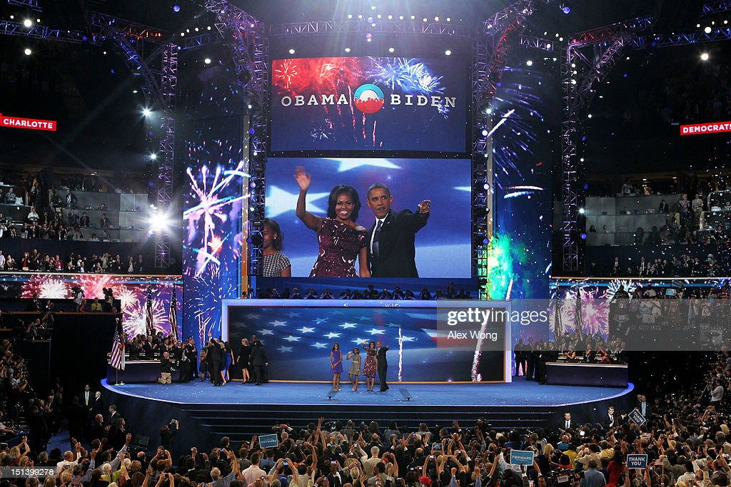 Democratic presidential candidate, U.S. President <a gi-track='captionPersonalityLinkClicked' href=/galleries/search?phrase=Barack+Obama&family=editorial&specificpeople=203260 ng-click='$event.stopPropagation()'>Barack Obama</a> stands on stage with First lady <a gi-track='captionPersonalityLinkClicked' href=/galleries/search?phrase=Michelle+Obama&family=editorial&specificpeople=2528864 ng-click='$event.stopPropagation()'>Michelle Obama</a>, <a gi-track='captionPersonalityLinkClicked' href=/galleries/search?phrase=Sasha+Obama&family=editorial&specificpeople=2631619 ng-click='$event.stopPropagation()'>Sasha Obama</a> and Malia Obama after accepting the nomination during the final day of the Democratic National Convention at Time Warner Cable Arena on September 6, 2012 in Charlotte, North Carolina. The DNC, which concludes today, nominated U.S. President <a gi-track='captionPersonalityLinkClicked' href=/galleries/search?phrase=Barack+Obama&family=editorial&specificpeople=203260 ng-click='$event.stopPropagation()'>Barack Obama</a> as the Democratic presidential candidate.