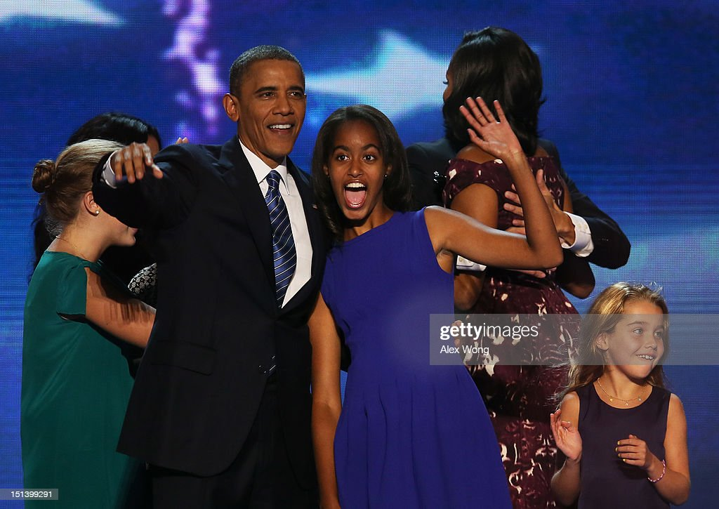 Democratic presidential candidate, U.S. President <a gi-track='captionPersonalityLinkClicked' href=/galleries/search?phrase=Barack+Obama&family=editorial&specificpeople=203260 ng-click='$event.stopPropagation()'>Barack Obama</a> stands on stage with <a gi-track='captionPersonalityLinkClicked' href=/galleries/search?phrase=Malia+Obama&family=editorial&specificpeople=2631620 ng-click='$event.stopPropagation()'>Malia Obama</a> after accepting the nomination during the final day of the Democratic National Convention at Time Warner Cable Arena on September 6, 2012 in Charlotte, North Carolina. The DNC, which concludes today, nominated U.S. President <a gi-track='captionPersonalityLinkClicked' href=/galleries/search?phrase=Barack+Obama&family=editorial&specificpeople=203260 ng-click='$event.stopPropagation()'>Barack Obama</a> as the Democratic presidential candidate.