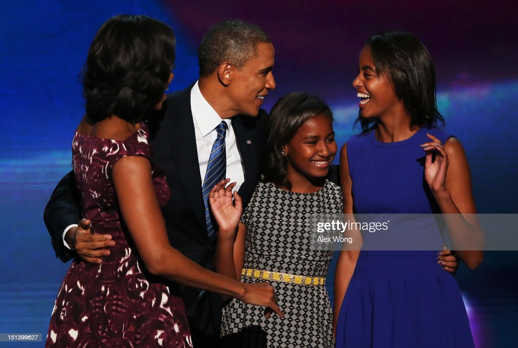 Democratic presidential candidate, U.S. President <a gi-track='captionPersonalityLinkClicked' href=/galleries/search?phrase=Barack+Obama&family=editorial&specificpeople=203260 ng-click='$event.stopPropagation()'>Barack Obama</a> stands on stage with his family (L-R) First lady <a gi-track='captionPersonalityLinkClicked' href=/galleries/search?phrase=Michelle+Obama&family=editorial&specificpeople=2528864 ng-click='$event.stopPropagation()'>Michelle Obama</a>, <a gi-track='captionPersonalityLinkClicked' href=/galleries/search?phrase=Sasha+Obama&family=editorial&specificpeople=2631619 ng-click='$event.stopPropagation()'>Sasha Obama</a> and <a gi-track='captionPersonalityLinkClicked' href=/galleries/search?phrase=Malia+Obama&family=editorial&specificpeople=2631620 ng-click='$event.stopPropagation()'>Malia Obama</a> after accepting the nomination during the final day of the Democratic National Convention at Time Warner Cable Arena on September 6, 2012 in Charlotte, North Carolina. The DNC, which concludes today, nominated U.S. President <a gi-track='captionPersonalityLinkClicked' href=/galleries/search?phrase=Barack+Obama&family=editorial&specificpeople=203260 ng-click='$event.stopPropagation()'>Barack Obama</a> as the Democratic presidential candidate.