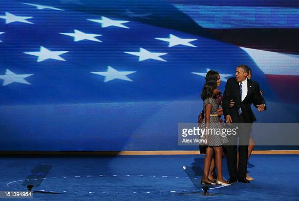 Democratic presidential candidate US President Barack Obama stands with his family First lady Michelle Obama Sasha Obama and Malia Obama after...