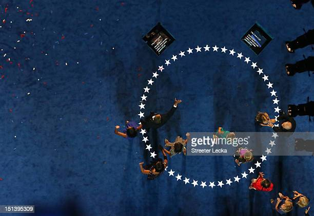 Democratic presidential candidate US President Barack Obama waves on stage with his family along with Democratic vice presidential candidate US Vice...