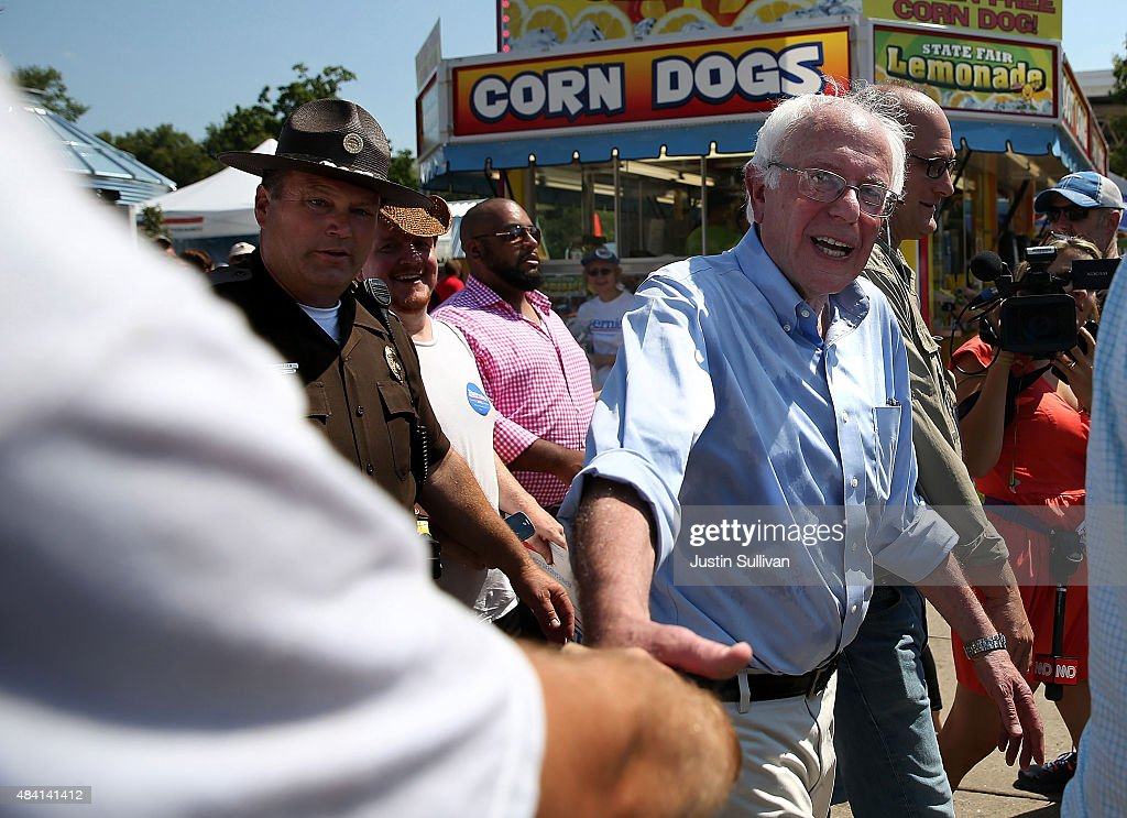 Democratic presidential candidate US Sen Bernie Sanders greets fairgoers as he tours the Iowa State Fair on August 15 2015 in Des Moines Iowa...
