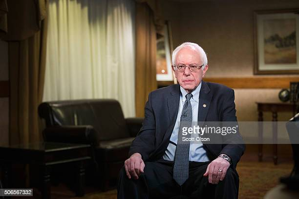 Democratic presidential candidate US Sen Bernie Sanders sits in a hotel conference room waiting for the start of an interview with a network news...