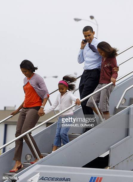 Democratic presidential candidate US Senator Barack Obama his wife Michelle and daughters Malia and Sacha disembarks from a plane at Indianapolis...