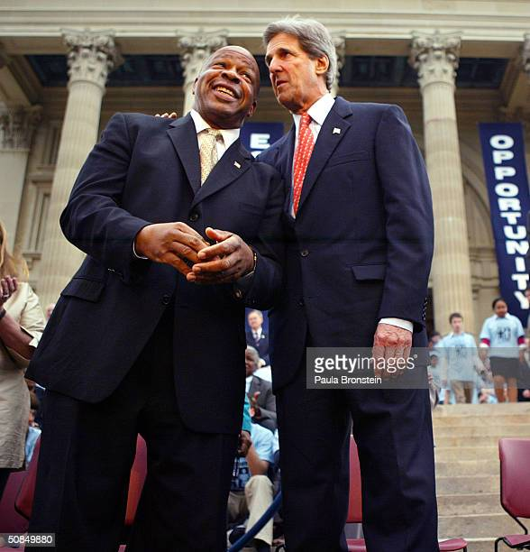 Democratic presidential candidate US Senator John Kerry chats with US Congressman Elijah Cummings during a ceremony to commemorate the 50th...