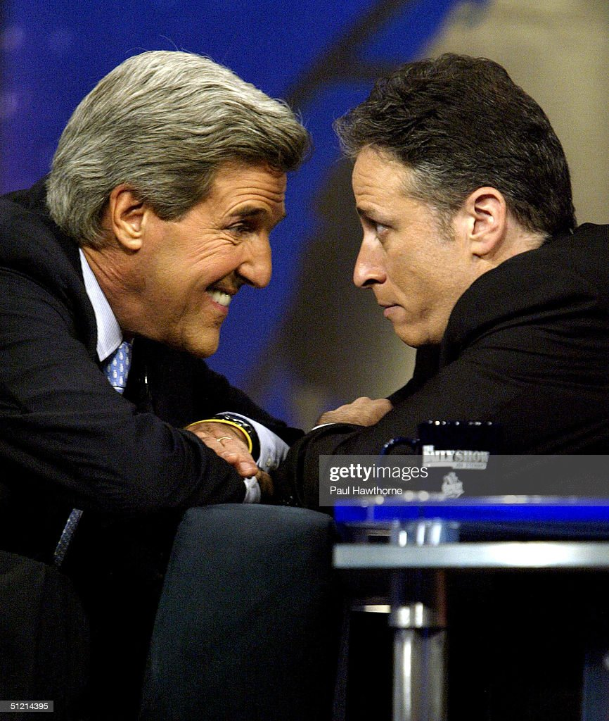 Democratic presidential candidate U.S. Senator John Kerry (D-MA) (L) goes eye to eye with show host Jon Stewart during a visit to the 'The Daily Show with Jon Stewart' August 24, 2004 in New York City.