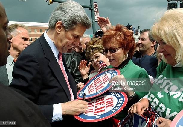 Democratic presidential candidate US Senator John Kerry signs campaign posters for supporters after a rally at Federal Plaza April 27 2004 in...