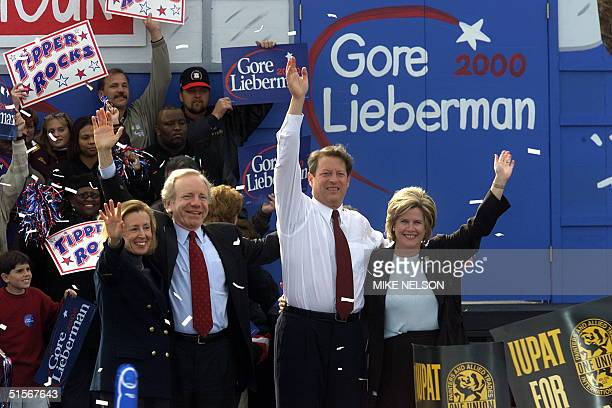 Democratic Presidential candidate US Vice President Al Gore and his runningmate Senator Joe Lieberman and their wives Tipper and Hadassah wave from...