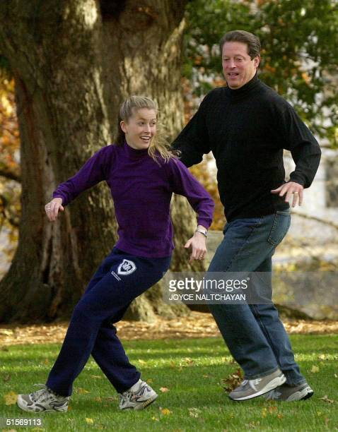 Democratic presidential candidate US Vice President Al Gore defends his daughter Karenna on a play during a touch football game with family members...