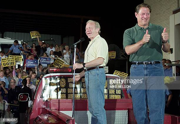 Democratic presidential candidate US Vice President Al Gore gives the thumbs up as his running mate US Senator Joe Lieberman talks to firefighters...