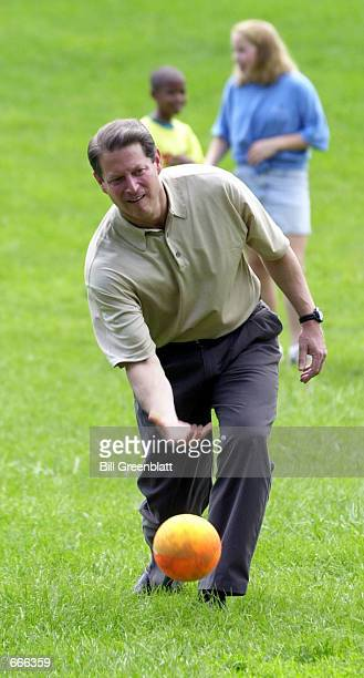 Democratic presidential candidate Vice President Al Gore pitches a kickball to a waiting YMCA summer camp student during a game of kickball in Ladue...