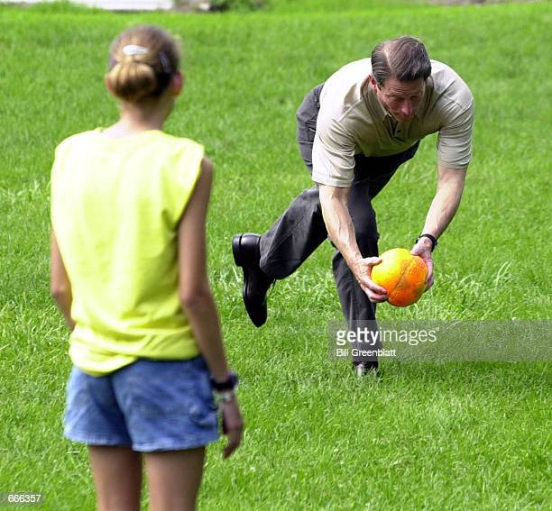 Democratic presidential candidate Vice President Al Gore takes aim as he pitches a kickball to a waiting YMCA summer camp student during a game of...