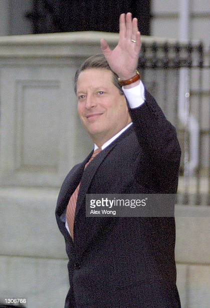 Democratic Presidential Candidate Vice President Al Gore waves to reporters November 29 2000 at the White House in Washington