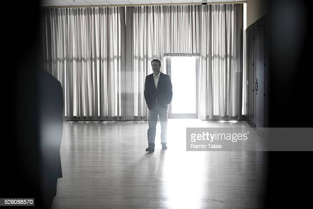 Democratic Presidential candidateJohn Edwards waits backstage before speaking at a campaign rally at Iowa State University in Ames