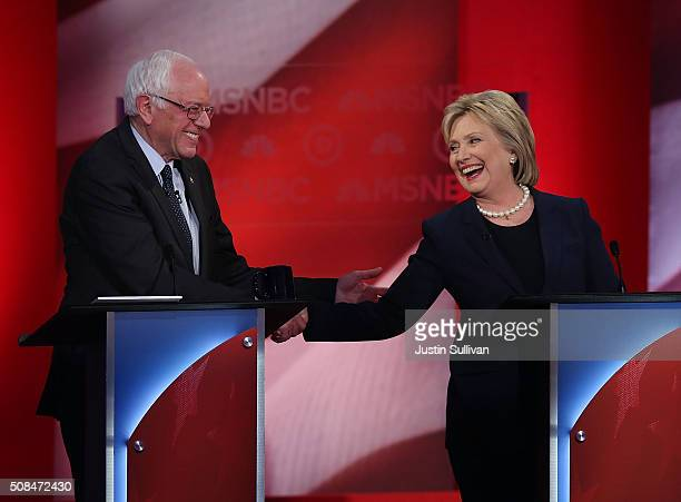 Democratic presidential candidates former Secretary of State Hillary Clinton and US Sen Bernie Sanders shake hands during their MSNBC Democratic...