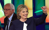 Democratic presidential candidates Sen Bernie Sanders and Hillary Clinton walk on the stage at the end of a presidential debate sponsored by CNN and...