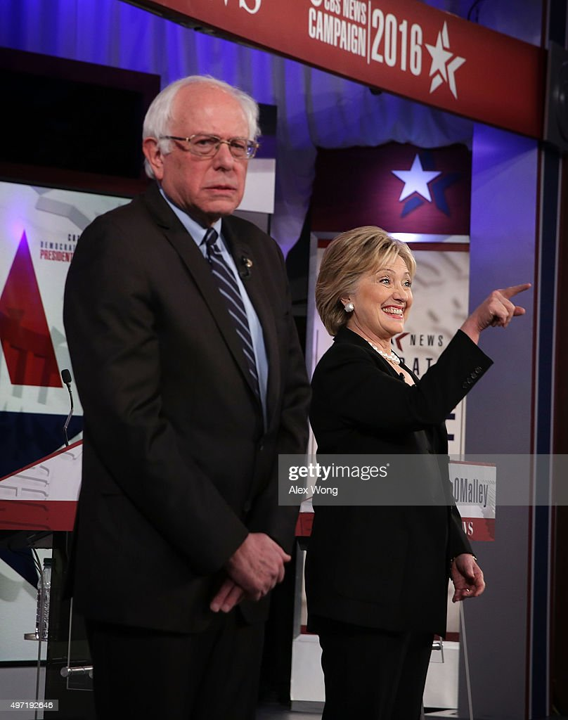 Democratic presidential candidates Sen Bernie Sanders and Hillary Clinton stand on the stage prior to a presidential debate sponsored by CBS at Drake...