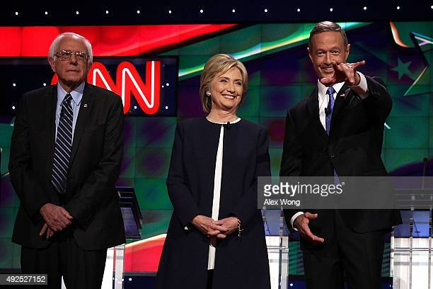 Democratic presidential candidates Sen Bernie Sanders Hillary Clinton and Martin O'Malley take the stage for a presidential debate sponsored by CNN...