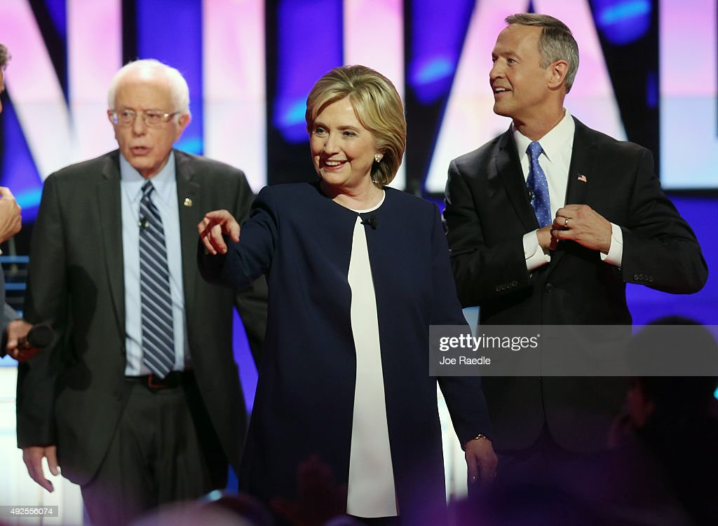 Democratic presidential candidates Sen Bernie Sanders Hillary Clinton and Martin O'Malley walk on the stage at the end of a presidential debate...
