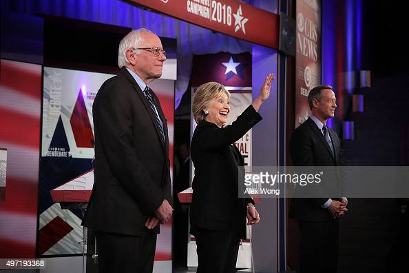 Democratic presidential candidates Sen Bernie Sanders Hillary Clinton and Martin O'Malley stand on the stage prior to a presidential debate sponsored...
