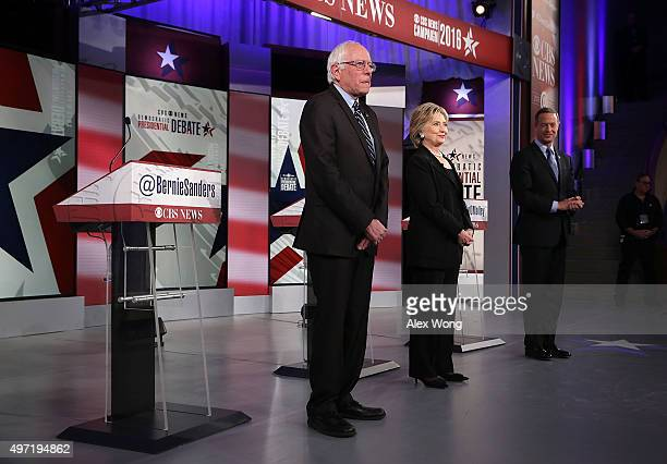 Democratic presidential candidates Sen Bernie Sanders Hillary Clinton and Martin O'Malley stand on the stage for posing for still photographers prior...